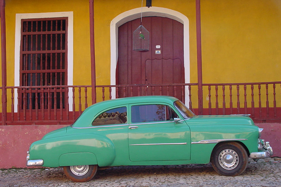 Oldtimer parked on a cobble-stone street in Cuba