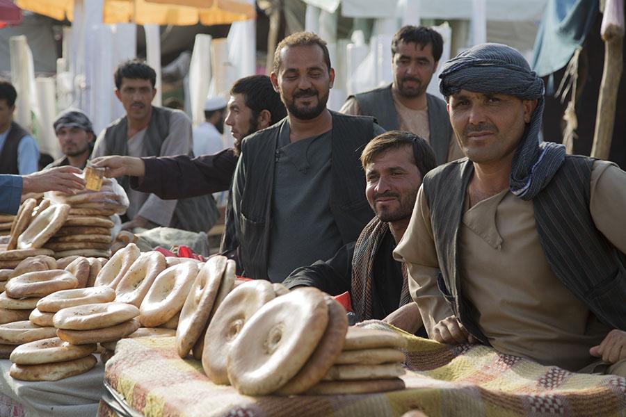 Men selling bread at the market of Mazar-i Sharif