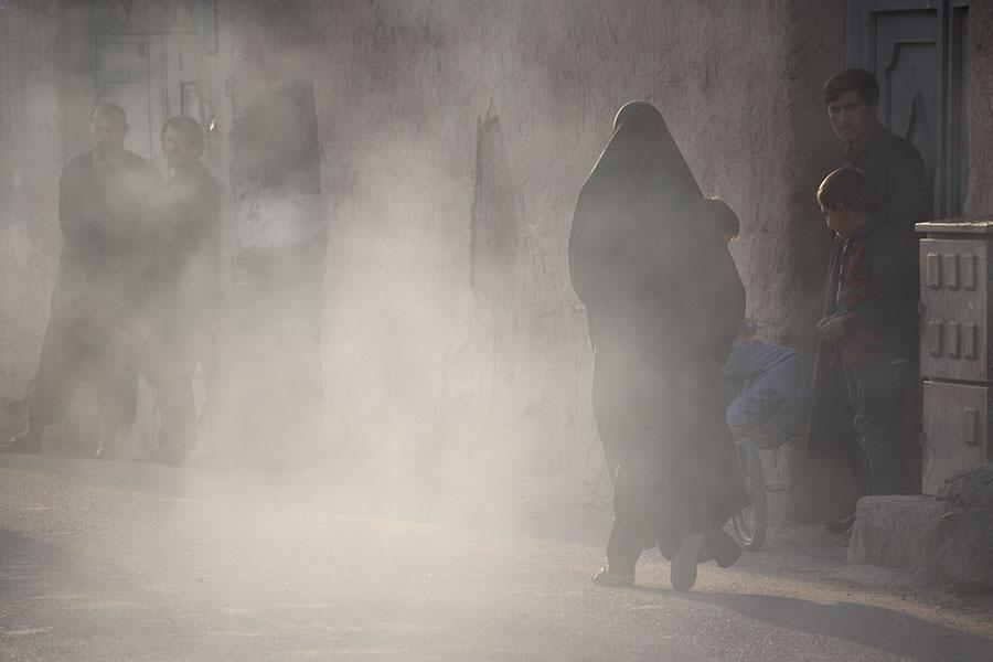 Woman on a dusty street in Herat