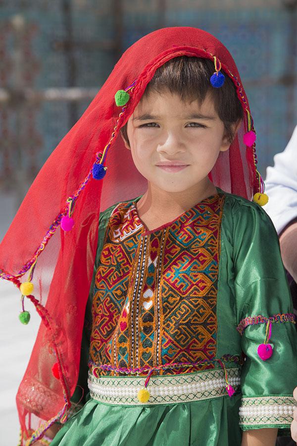 Girl with colourful dress in Mazar-i Sharif